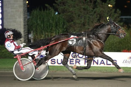 Hall of Fame driver John Campbell pilots Tony Soprano to a 1:55.1 victory in the two-year-old trotting colt Super Final at Woodbine Racetrack on Oct. 10. The colt was the second of two Super Final winners trained by Windsor, ON resident Bob McIntosh. (New Image Media photo)